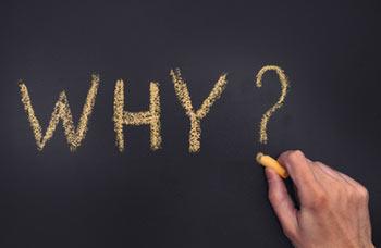 """""""Why"""" written on a blackboard"""