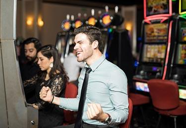 A happy man winning on slots